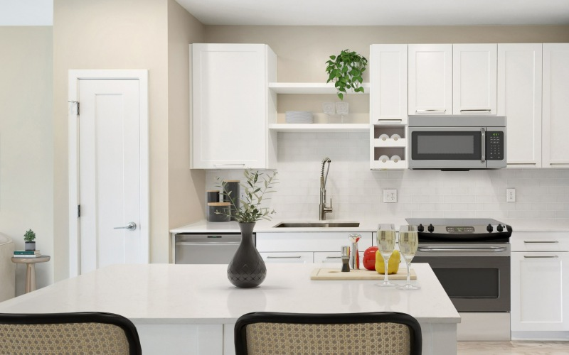 Kitchen With White Cabinetry At Aventon Crown Apartments